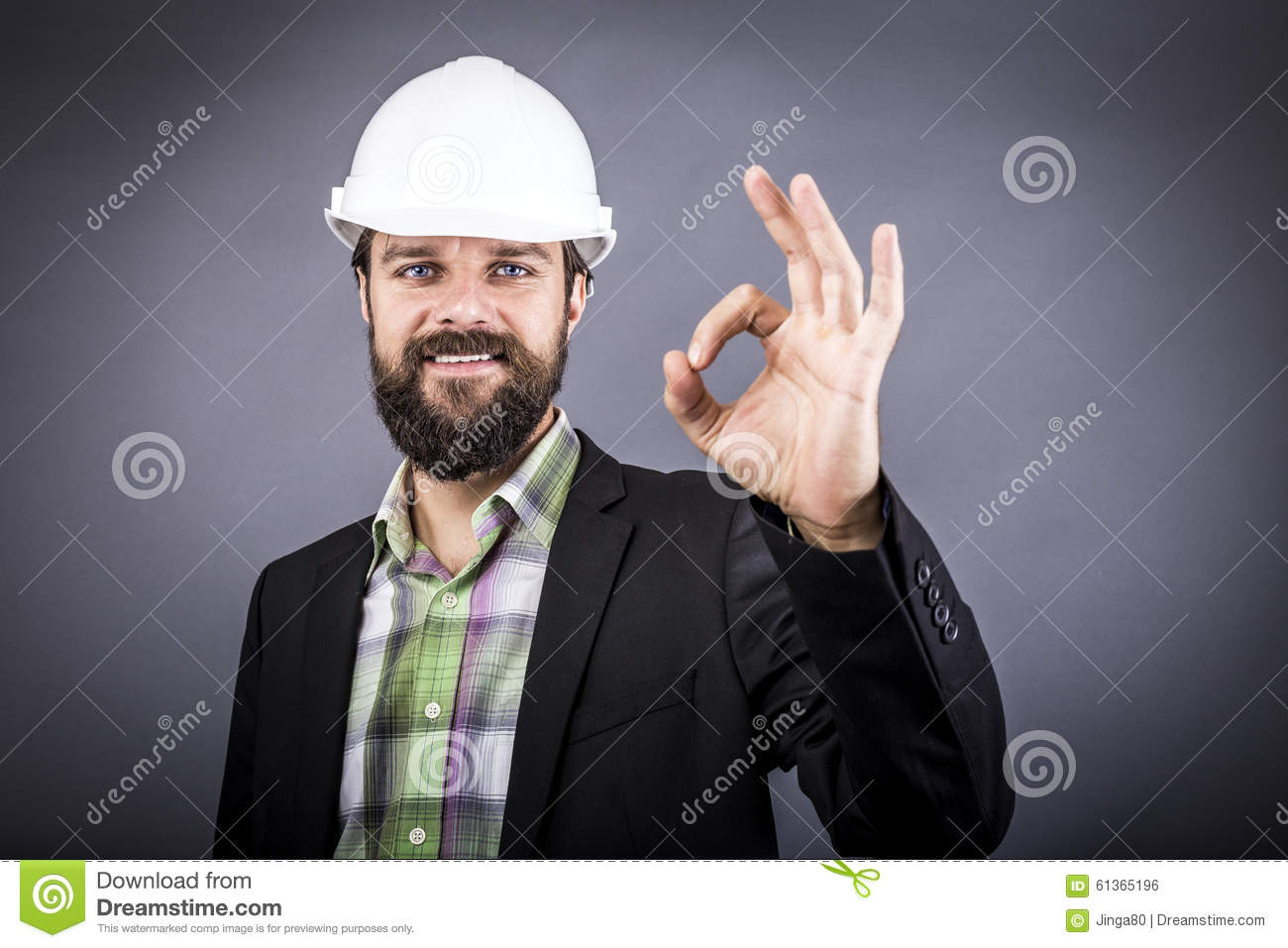 Happy young engineer with white hardhat showing ok sign