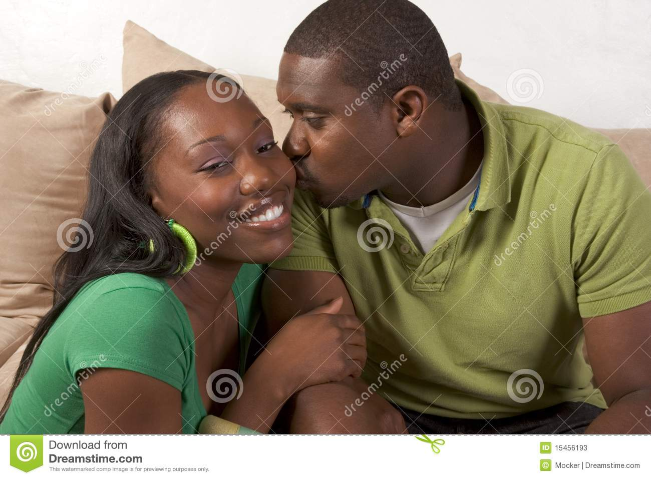 Happy Young Ethnic Black Couple Sitting On Couch Stock