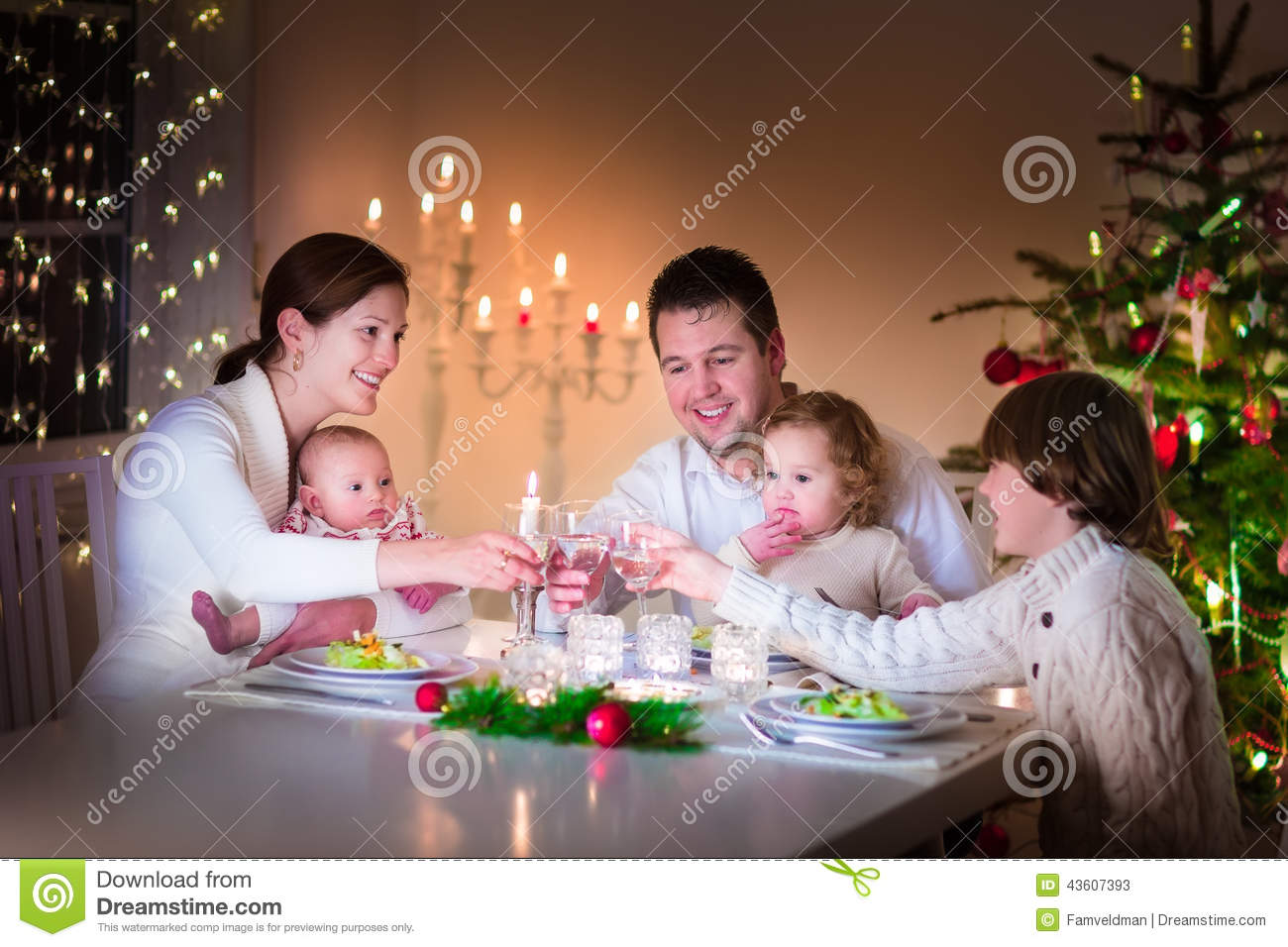 Happy Young Family At Christmas Dinner Stock Photo Image
