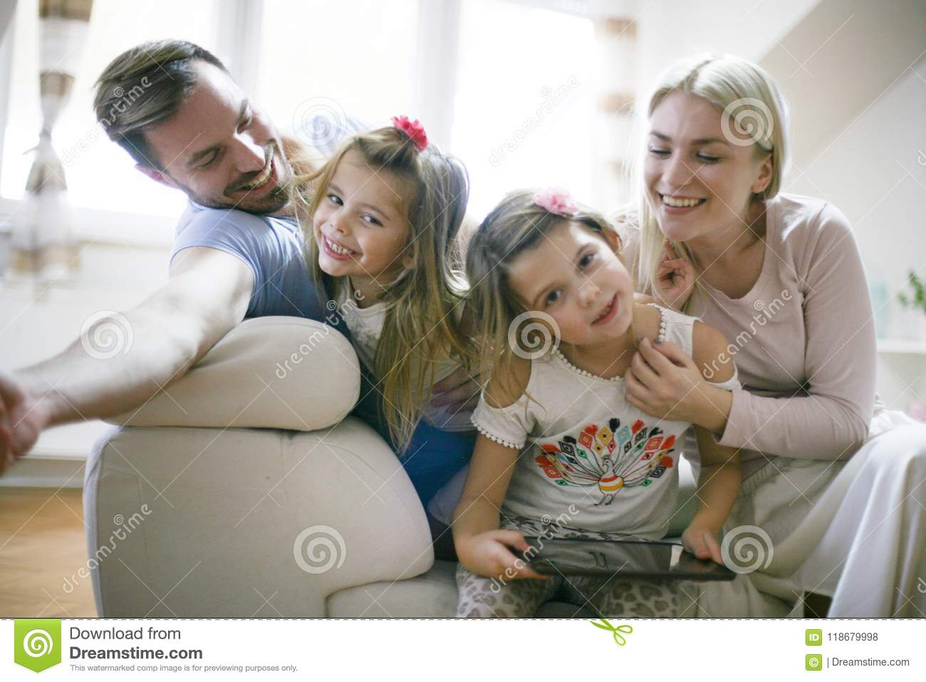 Happy young family at home.