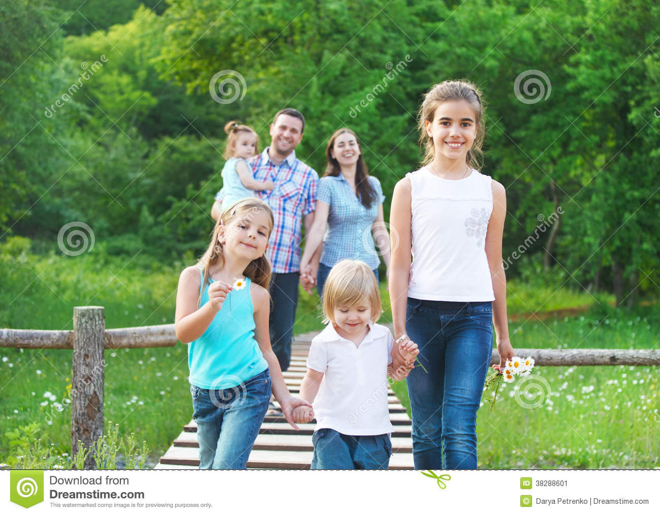 Happy young family with four children