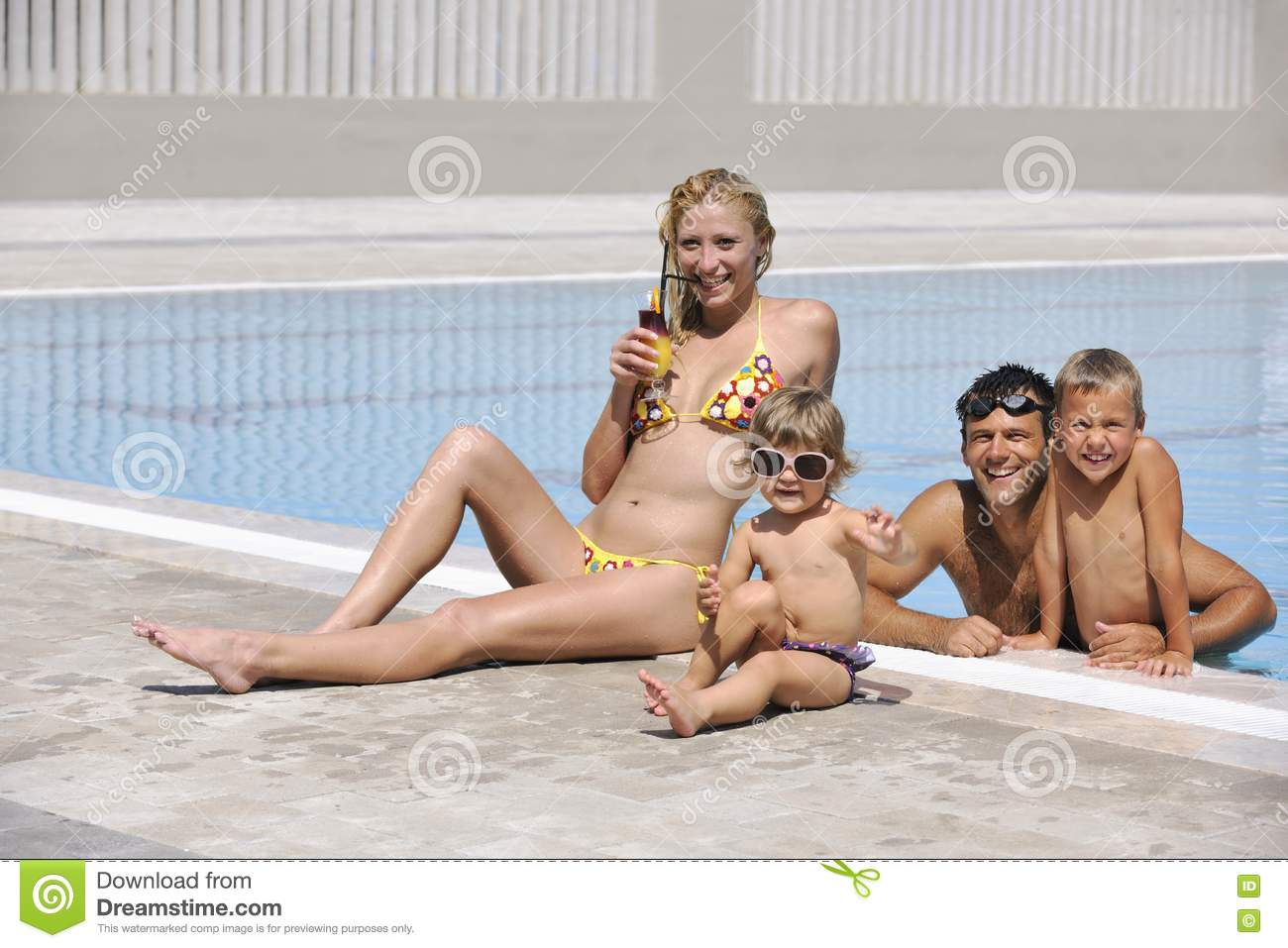 happy young family have fun on swimming pool stock photo   image