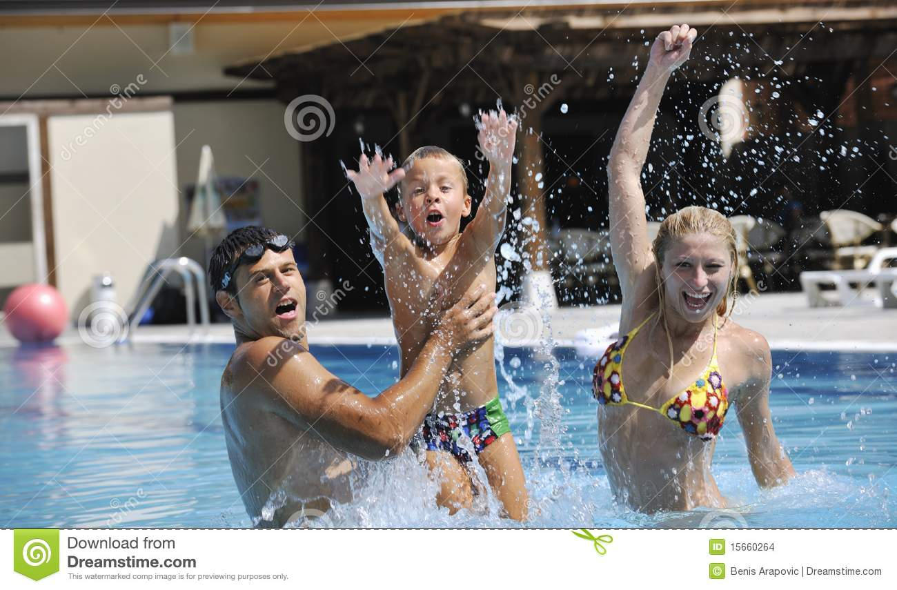 Happy young family have fun on swimming pool royalty free for Family swimming pool