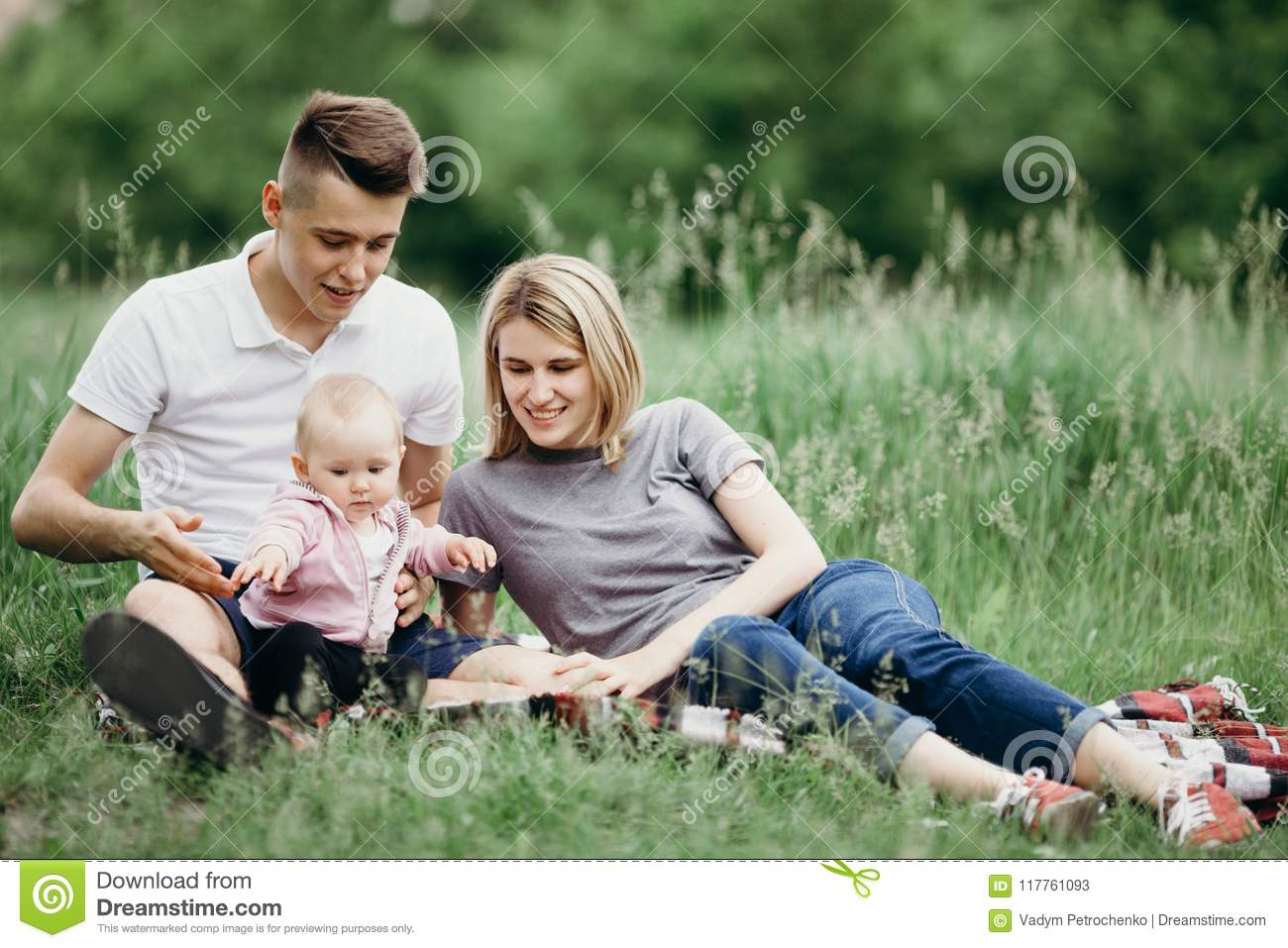 708e3efcad9 Happy Young Family Resting In Nature Together Stock Image - Image of ...