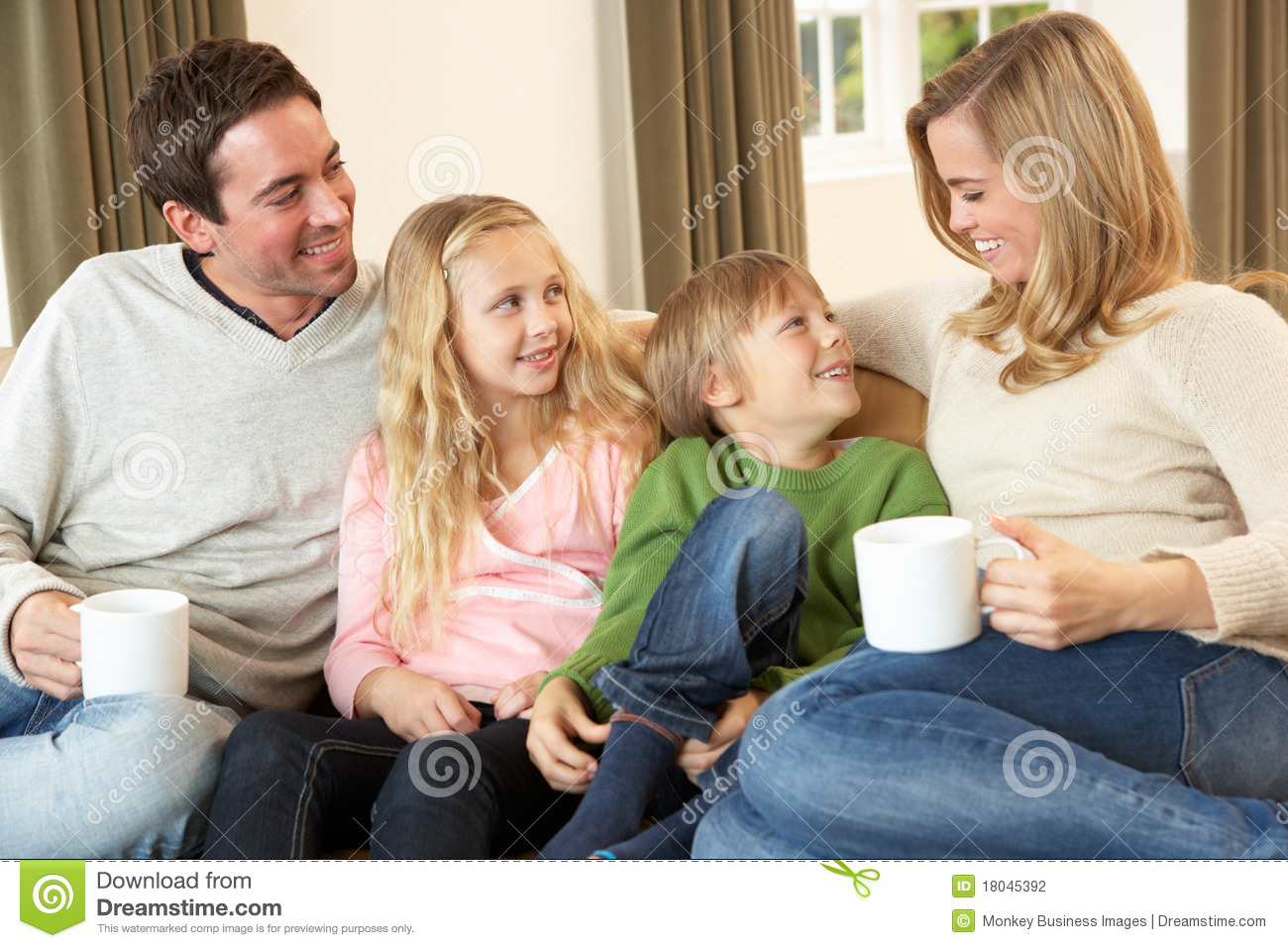 d9e0525ad7c Happy Young Family Sitting And Talking On Sofa Stock Photo - Image ...