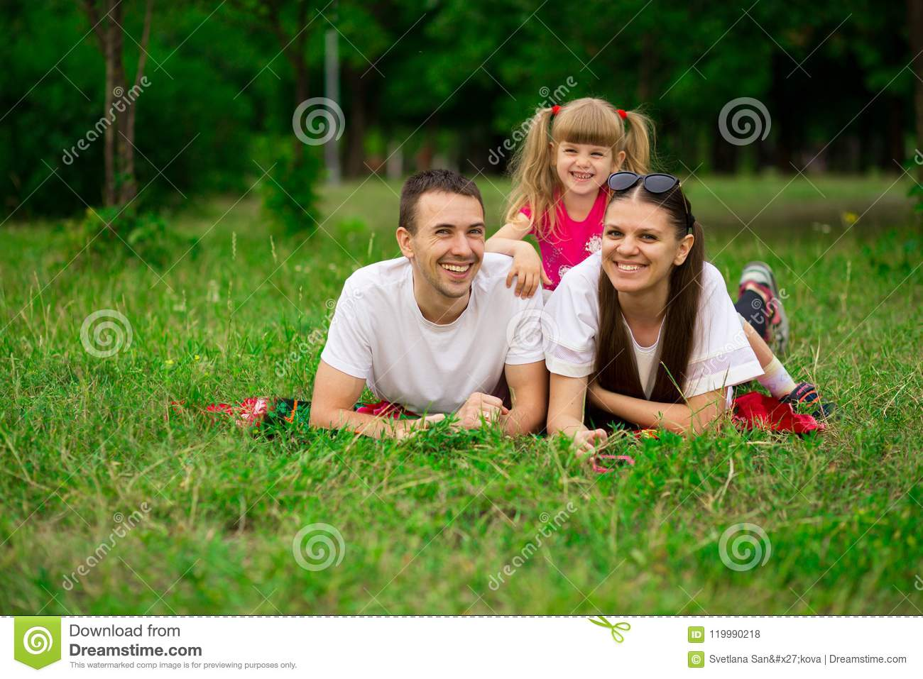 Happy young family spending time outdoor on summer day