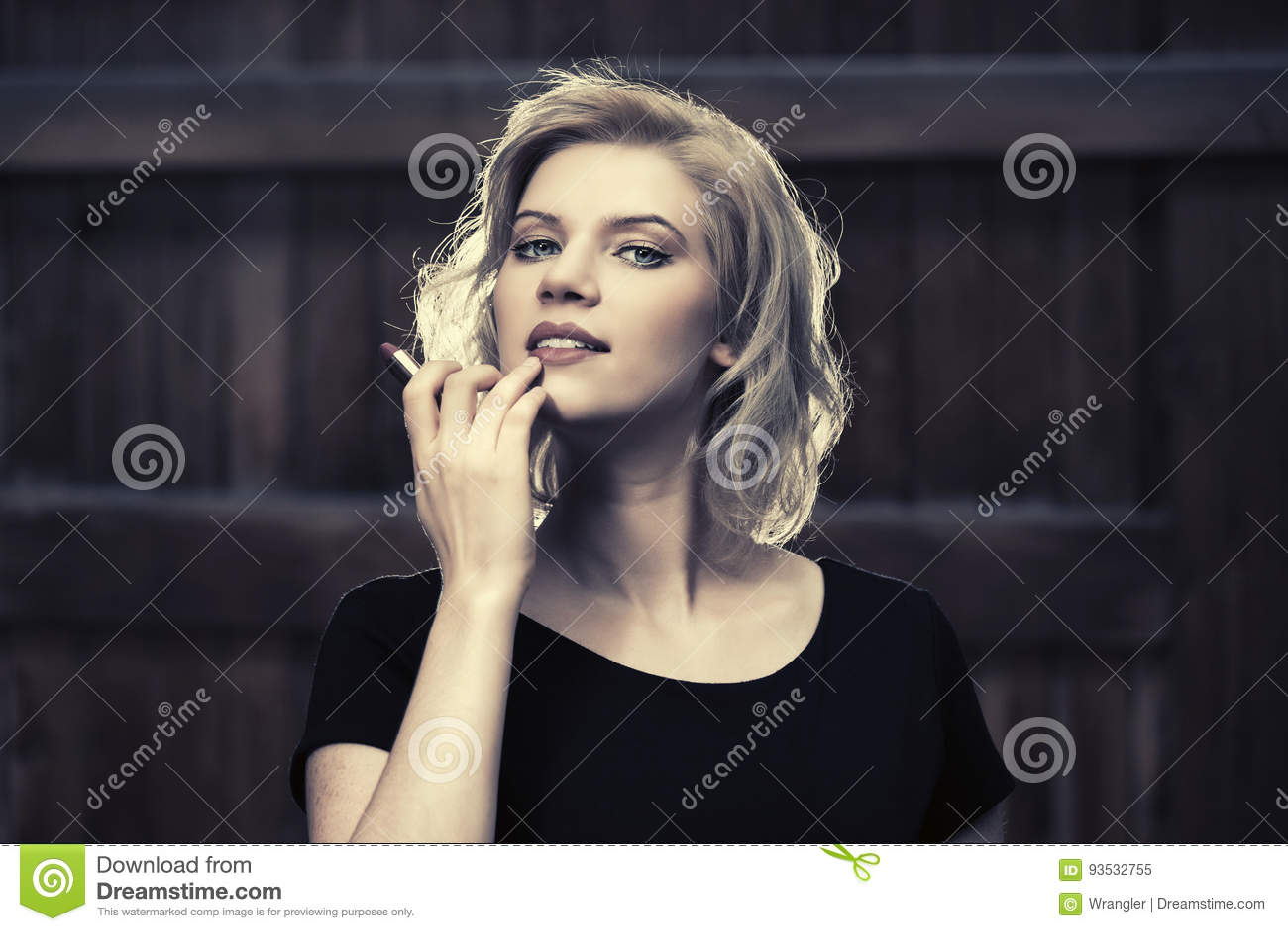 Black dress lipstick - Happy Young Fashion Woman In Black Dress Holding A Lipstick