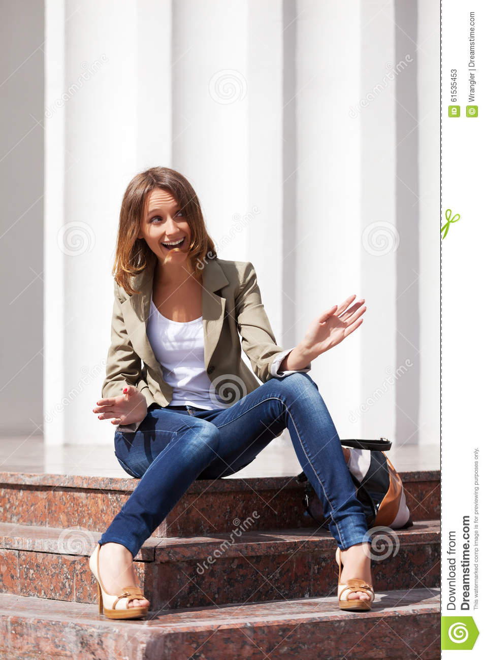 Young Fashion Woman With Shopping Bag Sitting On Mall Steps Royalty Free Stock Image