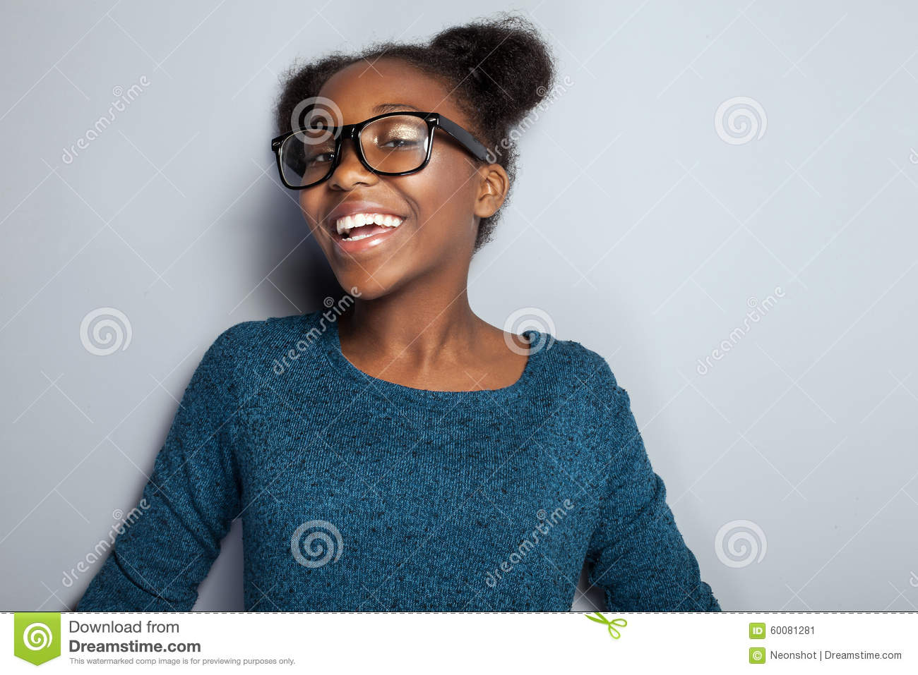 Happy young girl in eyeglasses.