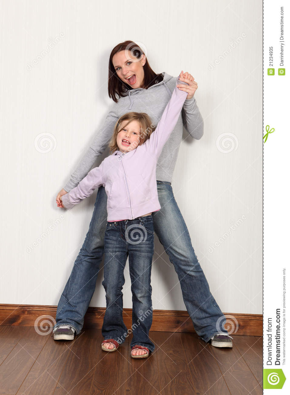 Happy young girl at home celebrating with her mum