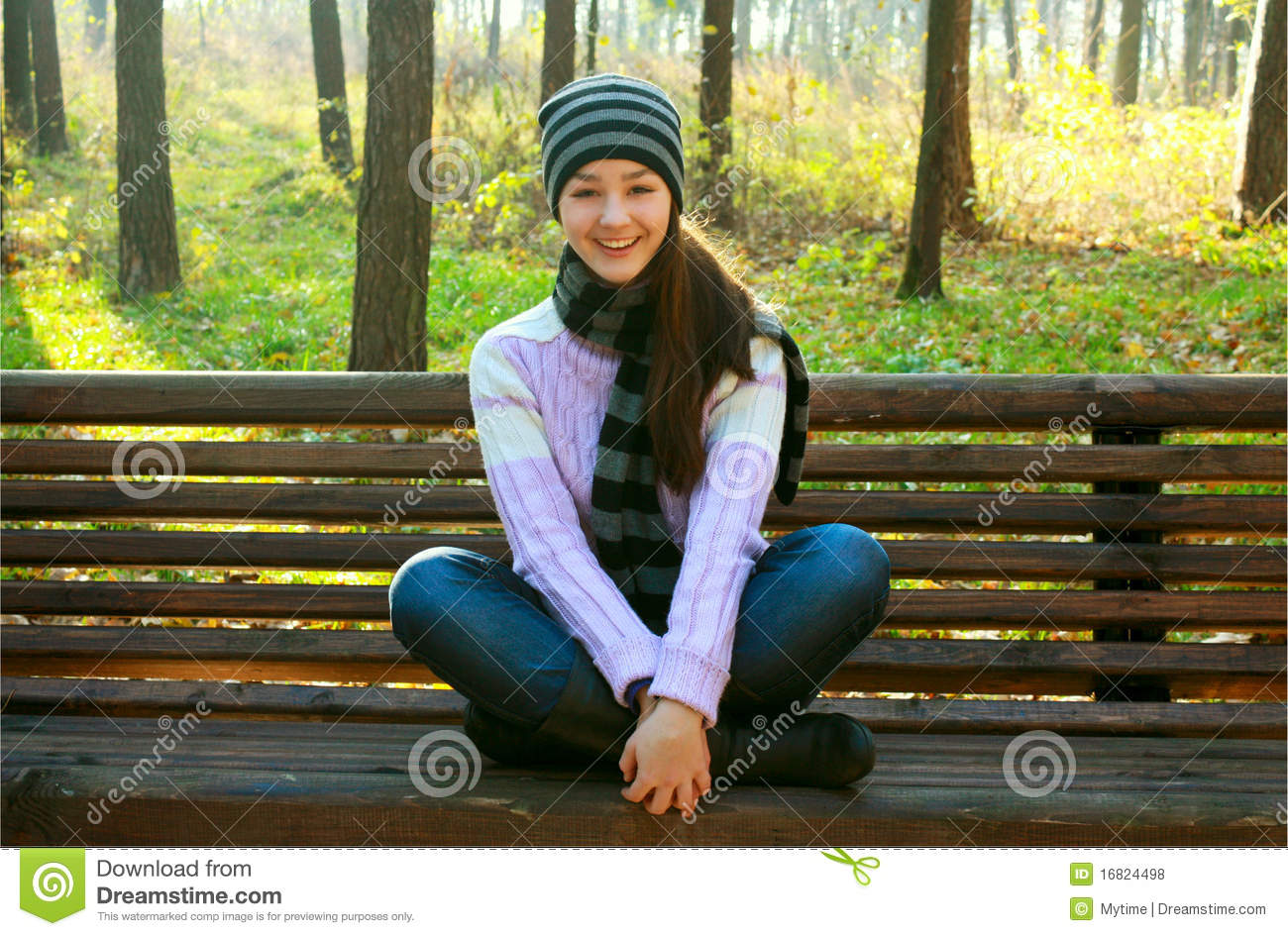 Happy Young Girl Sitting On Bench Royalty Free Stock Photos - Image ...