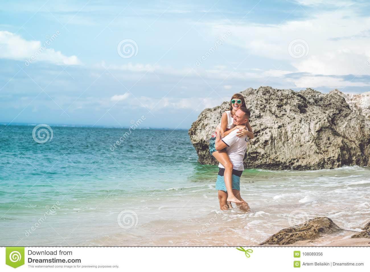 Happy Young Honeymoon Couple Having Fun On The Beach Ocean