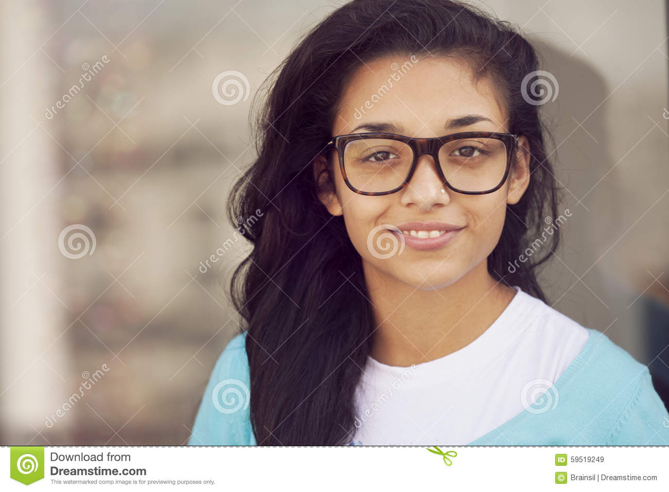 Happy young indian woman with glasses