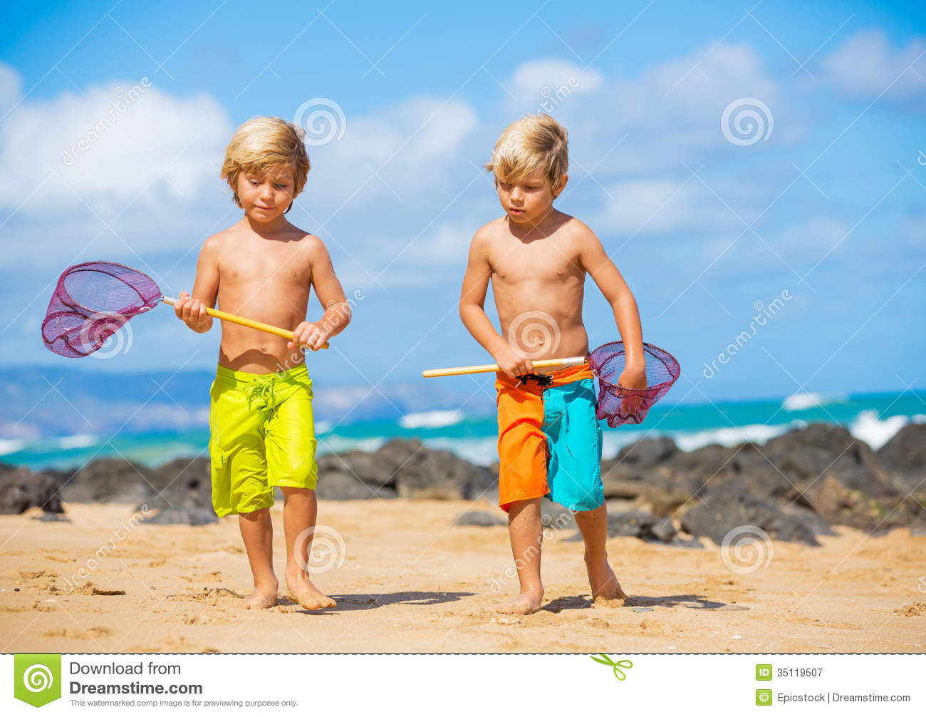 Happy Young Kids Playing At The Beach On Summer Vacation ...