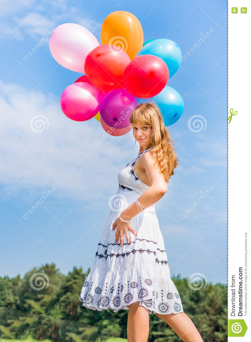 Happy Young Lady Celebrates Birthday And Playing With Balloons