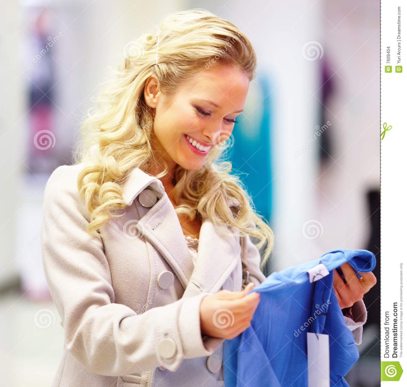 Happy Young Lady With A Sweet Smile Shopping Stock Photo