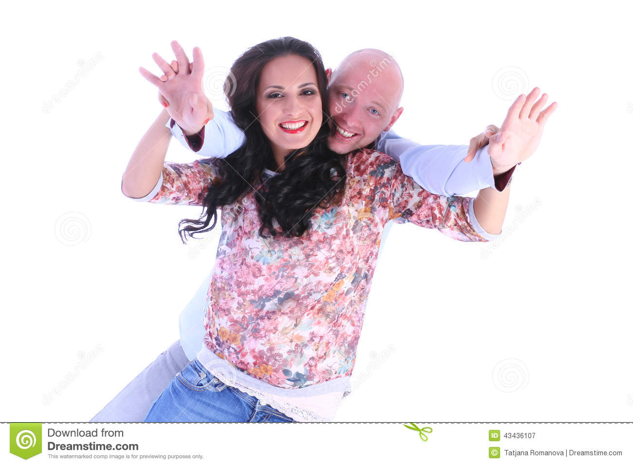 Happy young loving couple with arms open