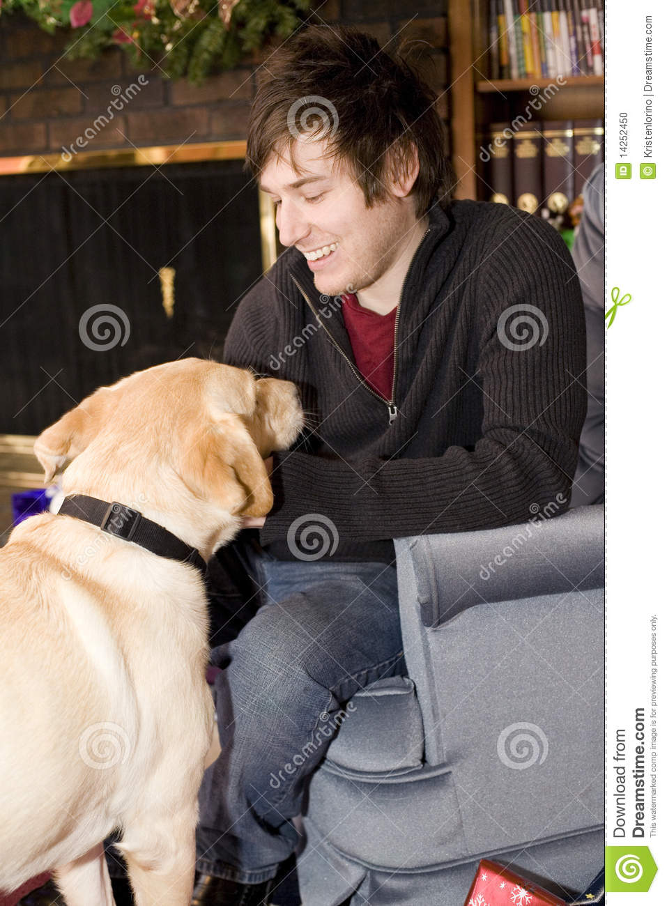 Man On Dog : Young man petting a puppy stock photography