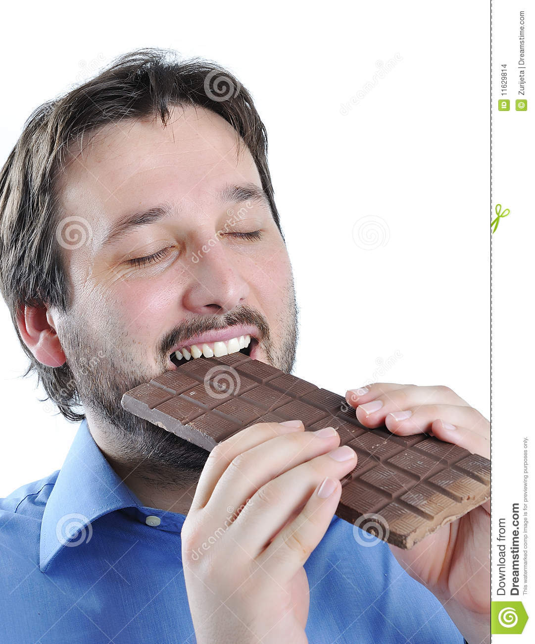 happy-young-man-eating-chocolate-1162981