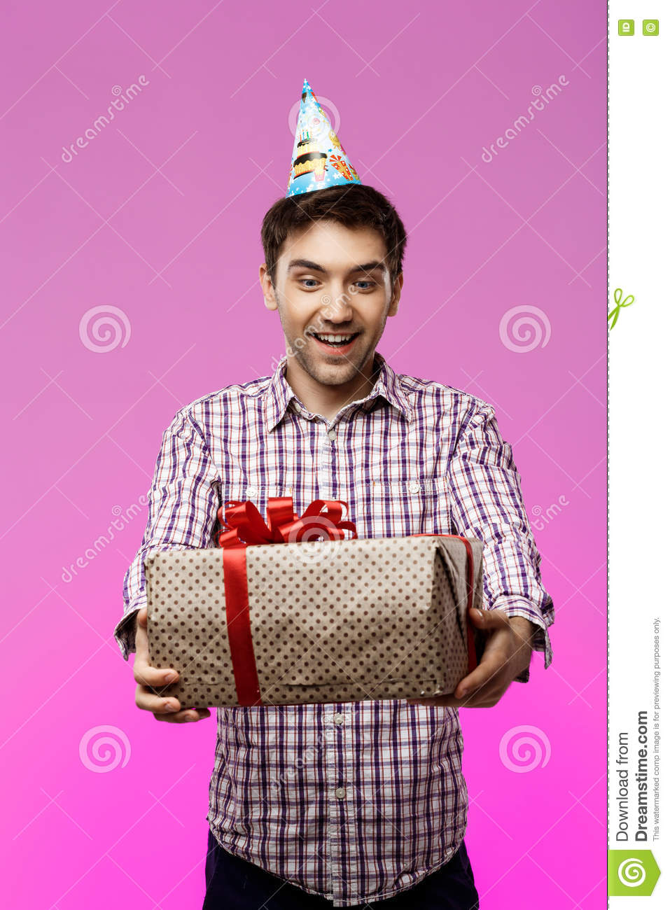 Happy Young Handsome Man Holding Birthday Gift In Box Over Purple Background Copy Space