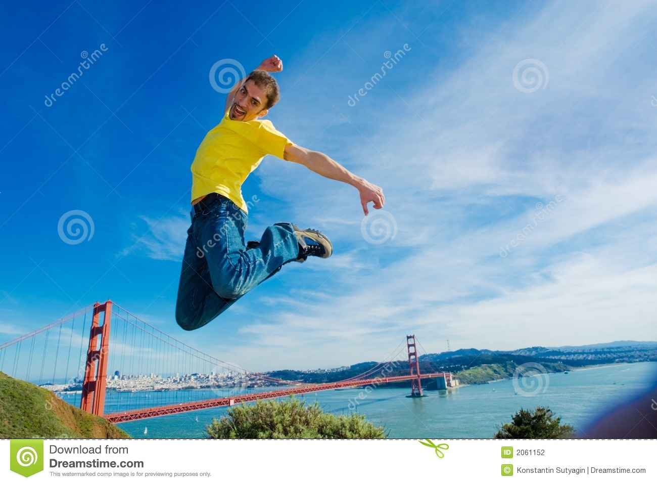 Happy young man jumping high in the air