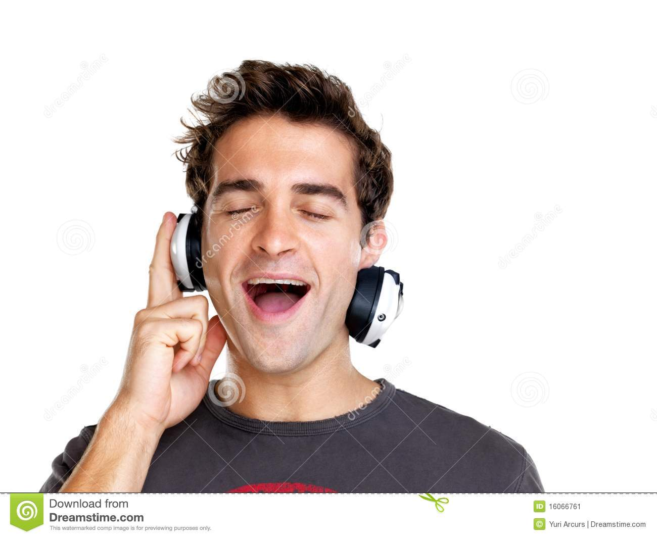 Stock Image: Happy young man listening to music with ...