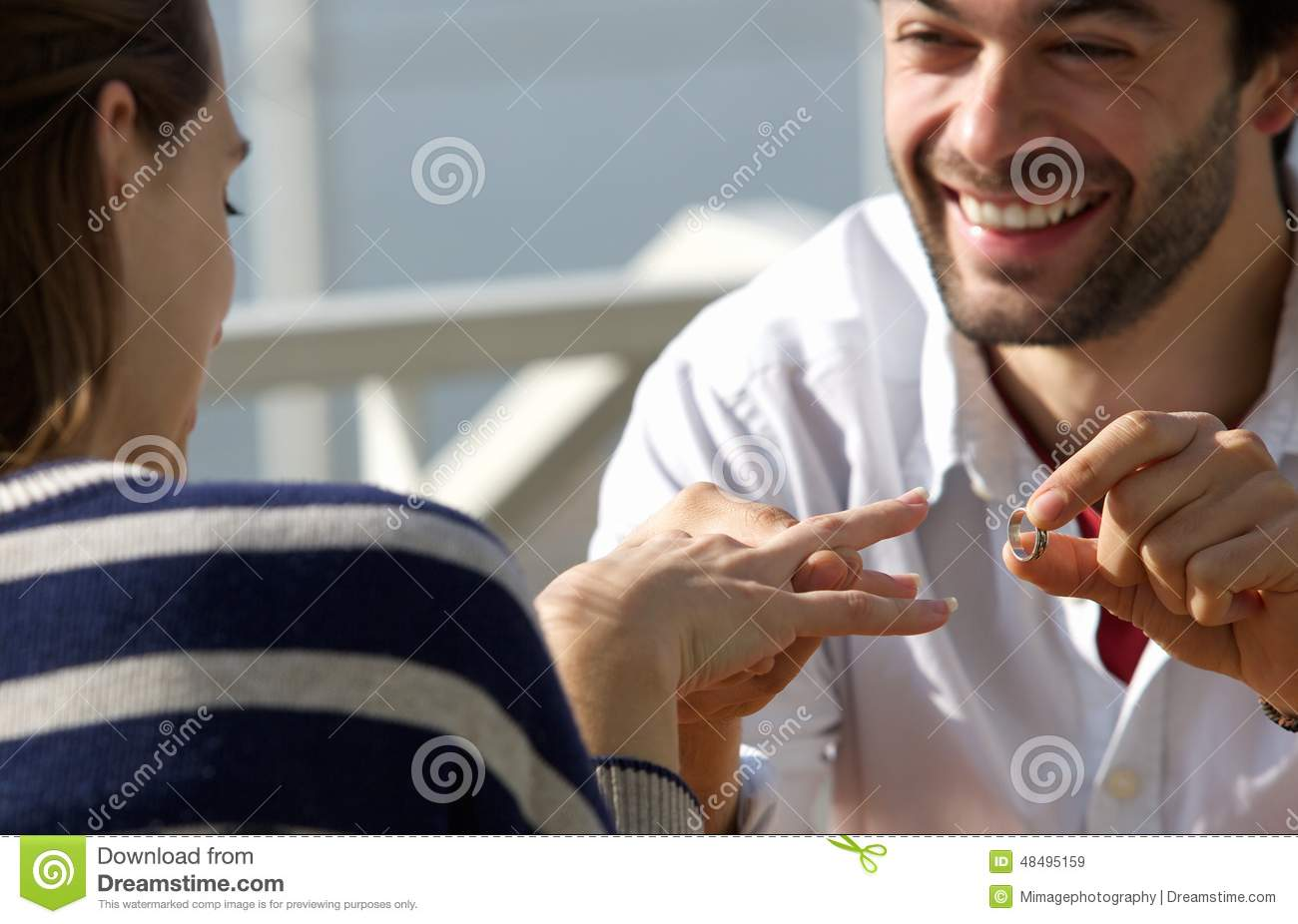 Happy Young Man Proposing Marriage To Woman With