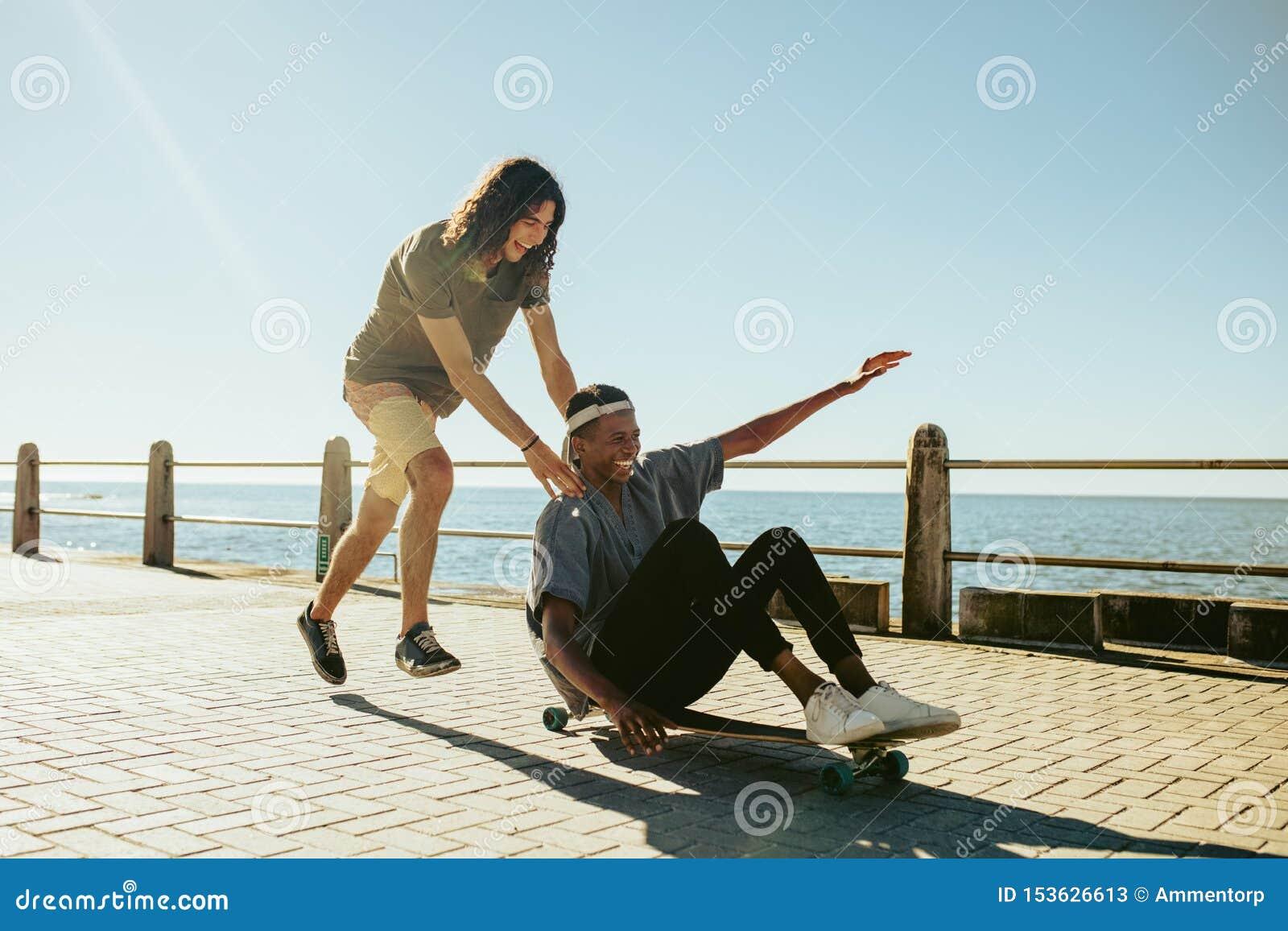 Boys enjoying outdoors on seaside road