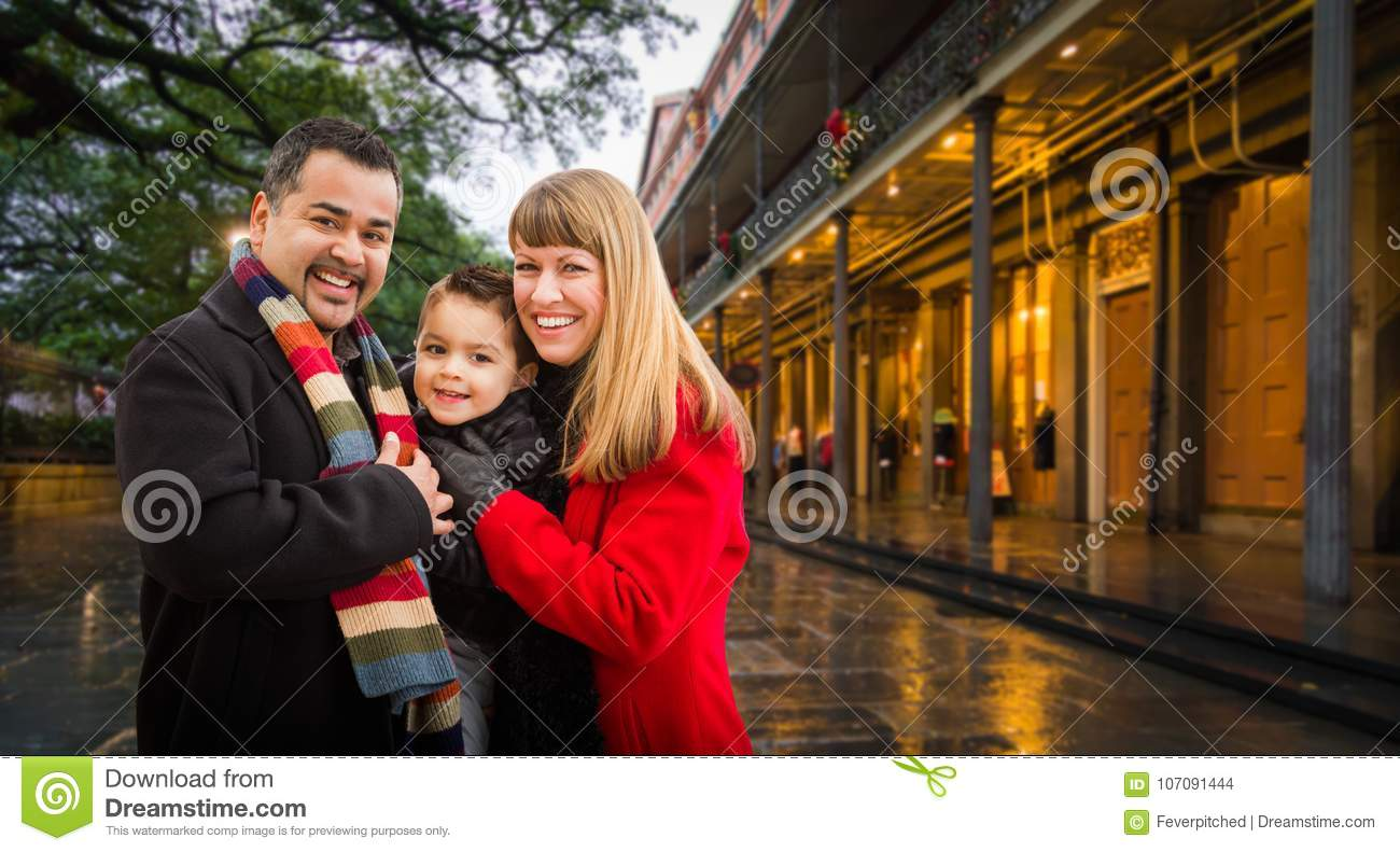 Happy Young Mixed Race Family Enjoying an Evening in New Orleans