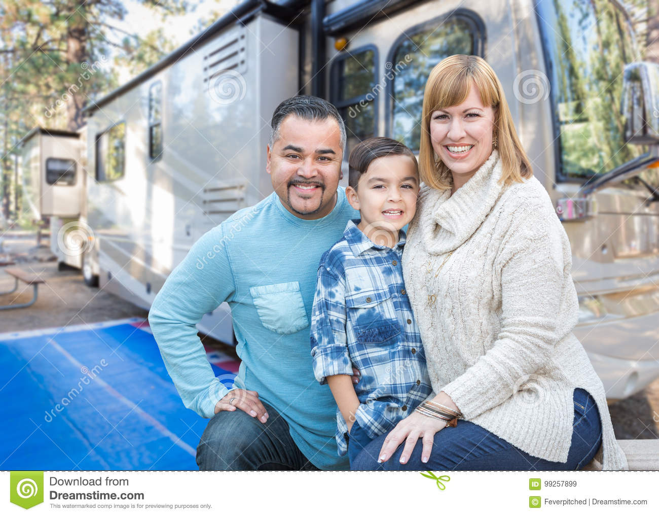 Happy Young Mixed Race Family In Front of Beautiful RV