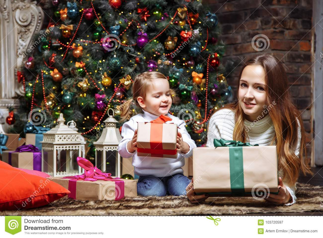 Happy Young Mother And Daughter With Christmas Gifts Stock Image ...