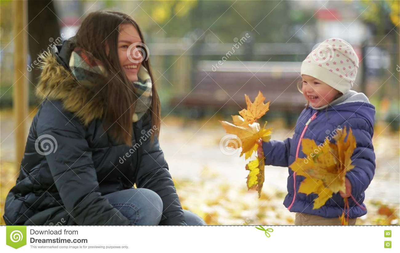 c93957c417e5 Happy Young Mother And Her Little Daughter Having Fun In An Autumn ...