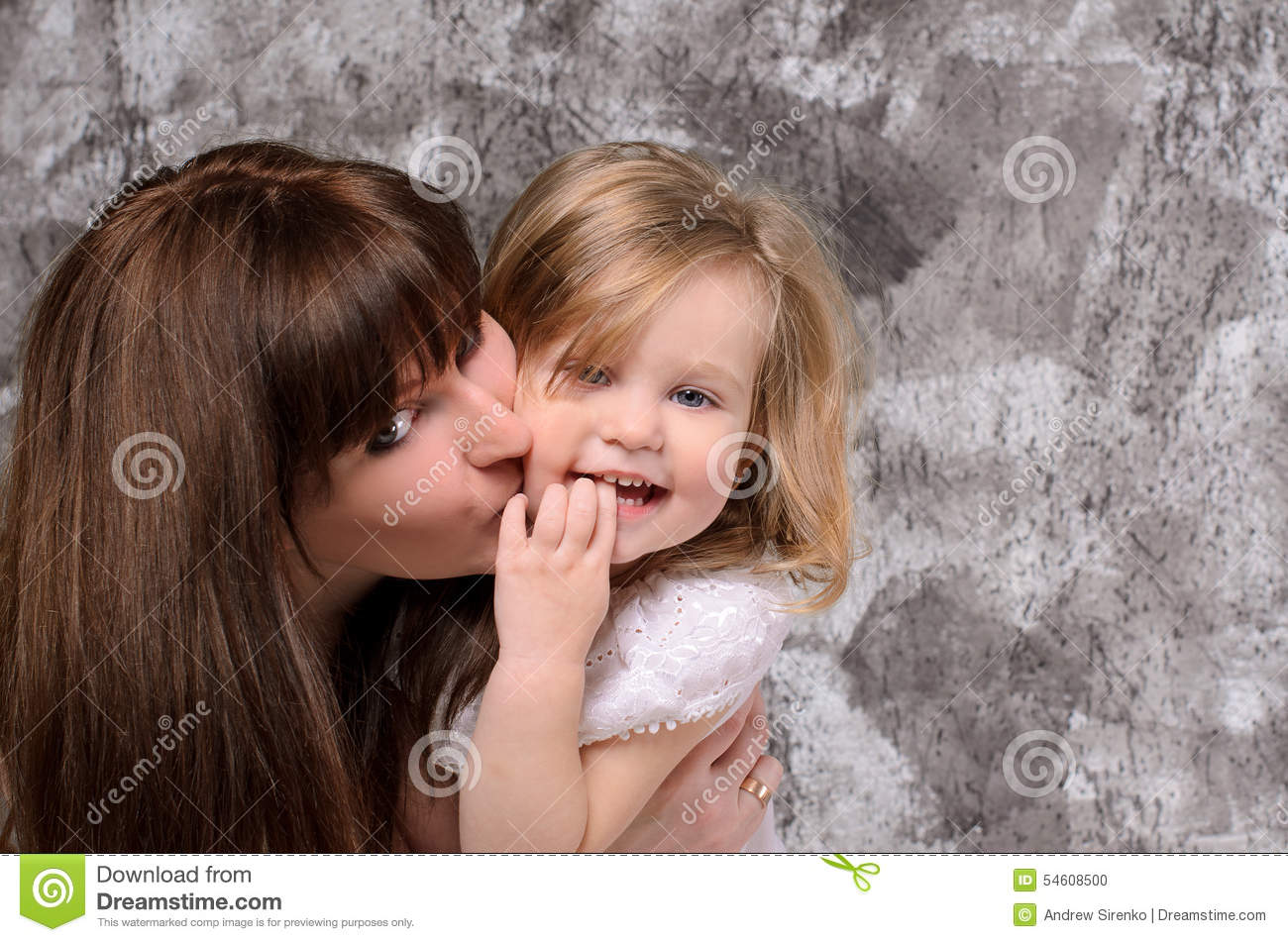 happy young mother and little daughter