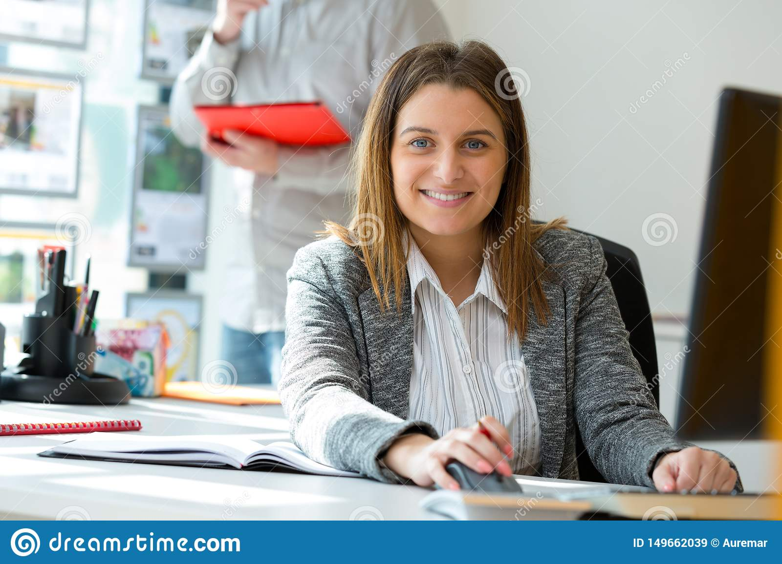 Happy young office woman