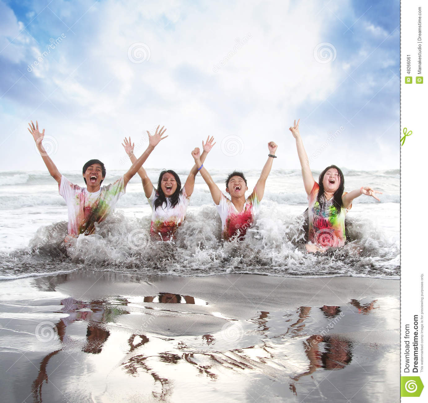 Happy young people enjoying a beach in summer with slow motion and blurry concept