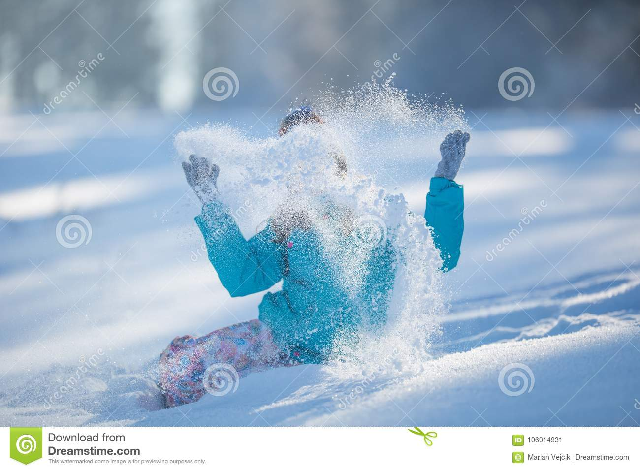 3c4bda91eec4 Happy Young Pre-Teen Girl In Warm Clothing Playing With Snow Stock ...