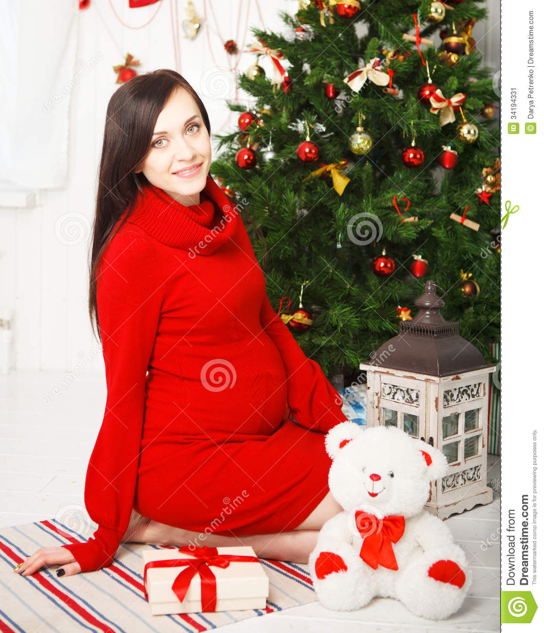 Happy Young Pregnant Woman Near The Christmas Tree Stock
