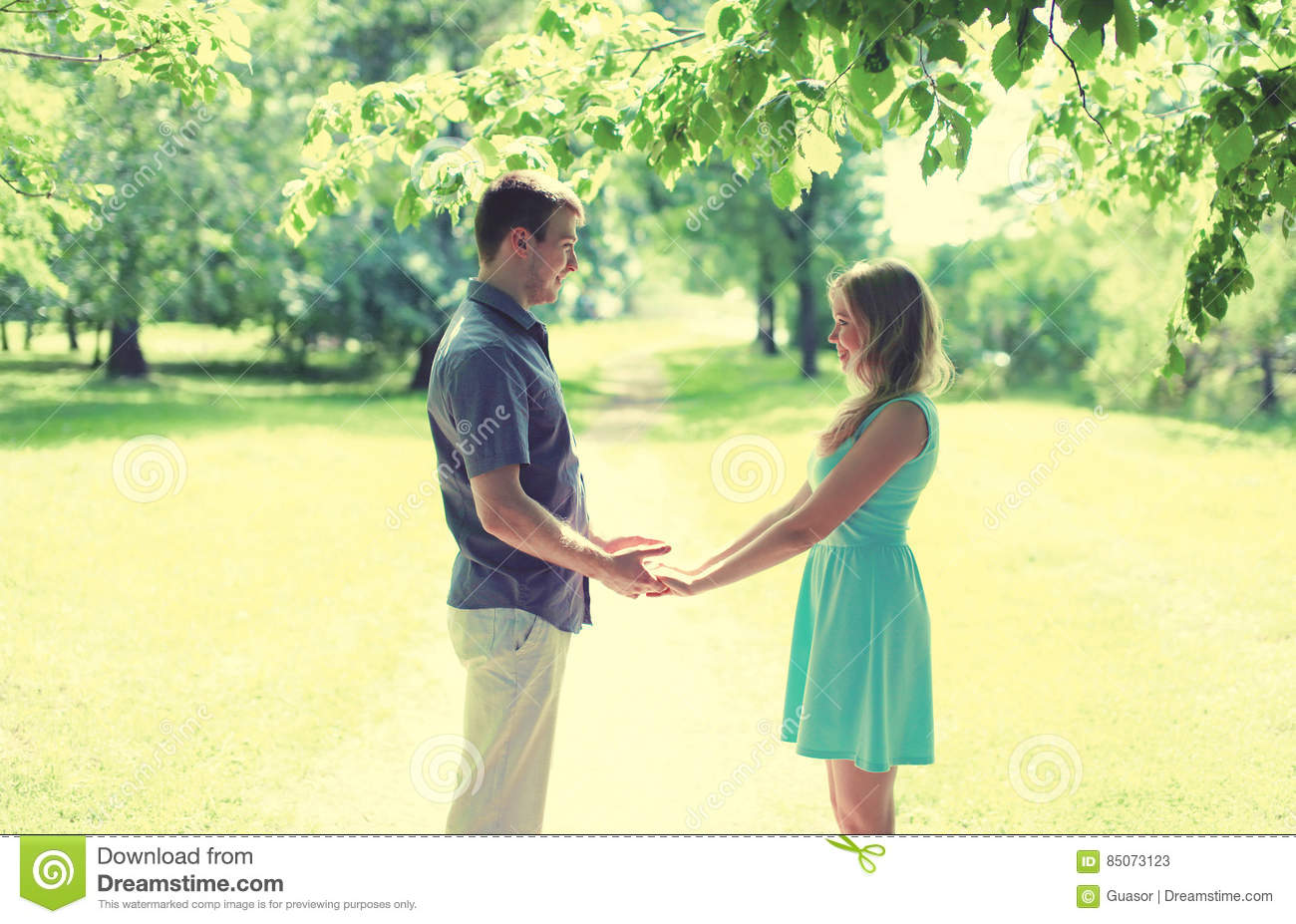 Happy young smiling couple in love, holds hands, relationships, date, wedding - concept, vintage soft colors