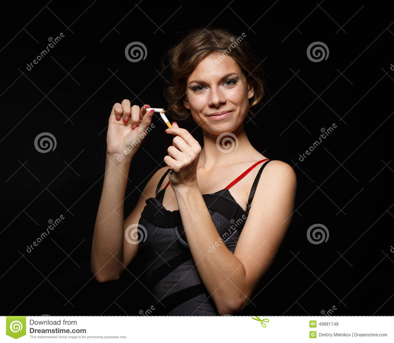 Happy Young Woman With The Broken Cigarette. Stock Photo ...
