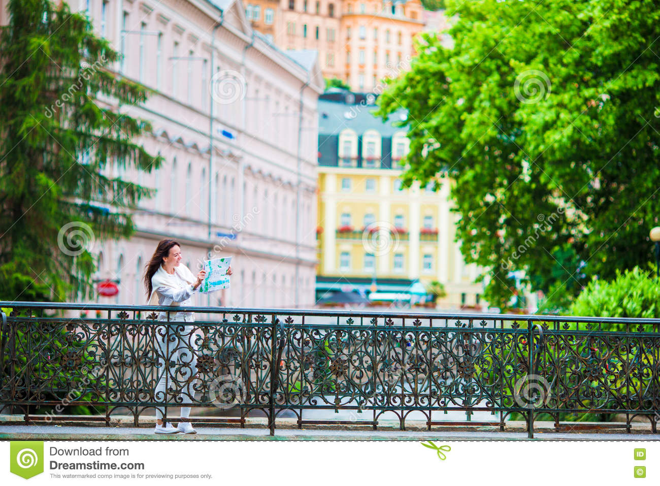 Happy Young Woman With A City Map In Europe. Travel Tourist Woman ...