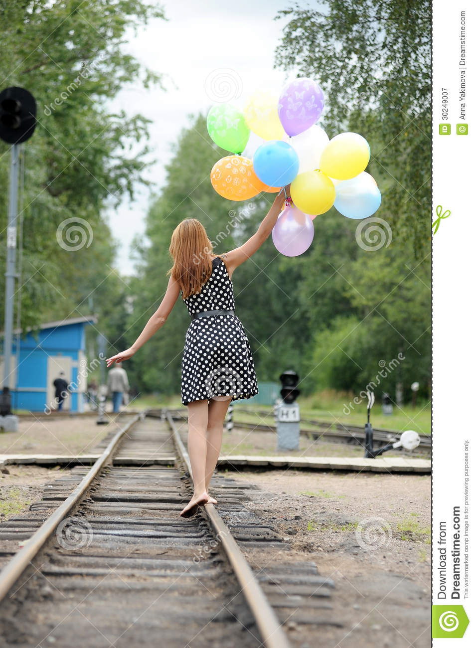Young Woman With Colorful Latex Balloons