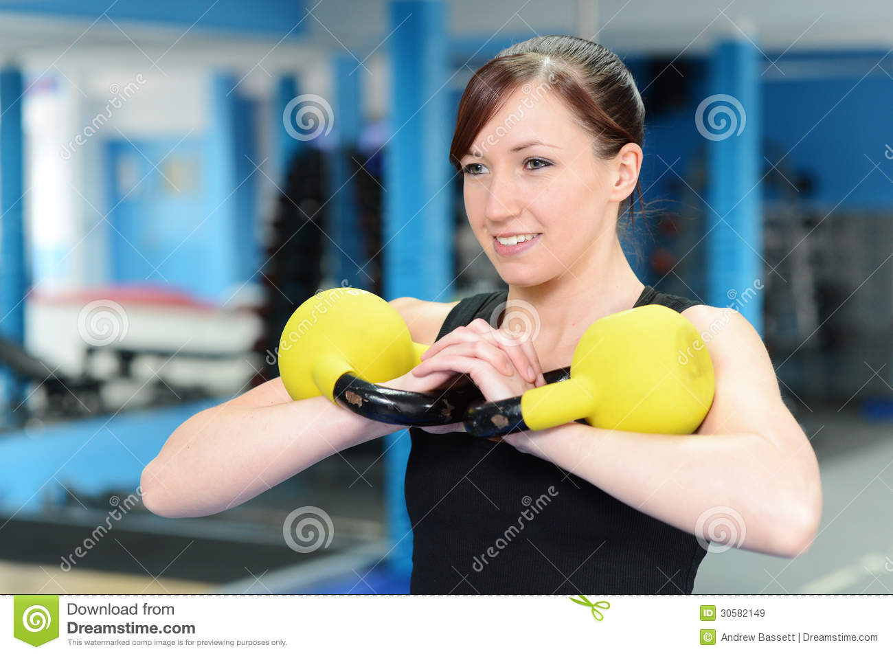 Happy Young Woman Exercising With Kettle Bell Weight ...