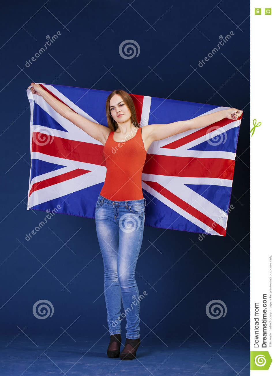 Happy young woman holding a flag of of Great Britain British fl