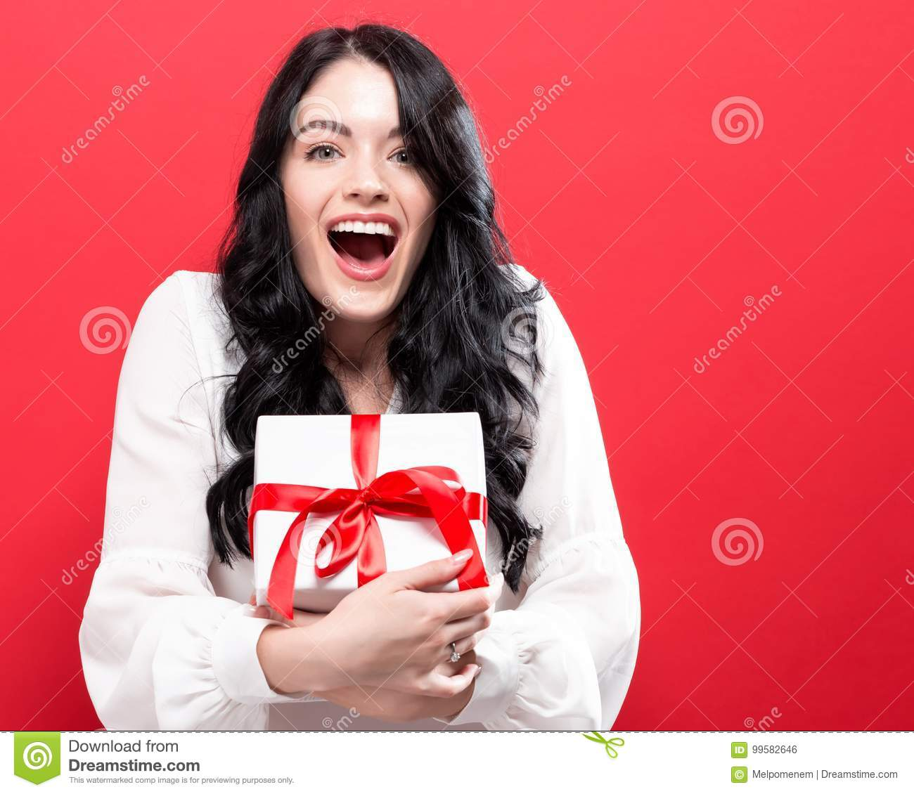 Download Happy Young Woman Holding A Gift Box Stock Photo - Image of love, craft: 99582646