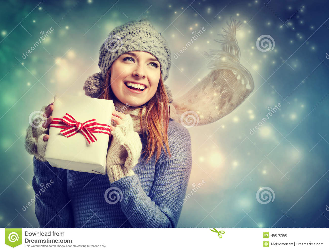 Download Happy Young Woman Holding A Present Box Stock Photo - Image of holiday, scarf: 48070380