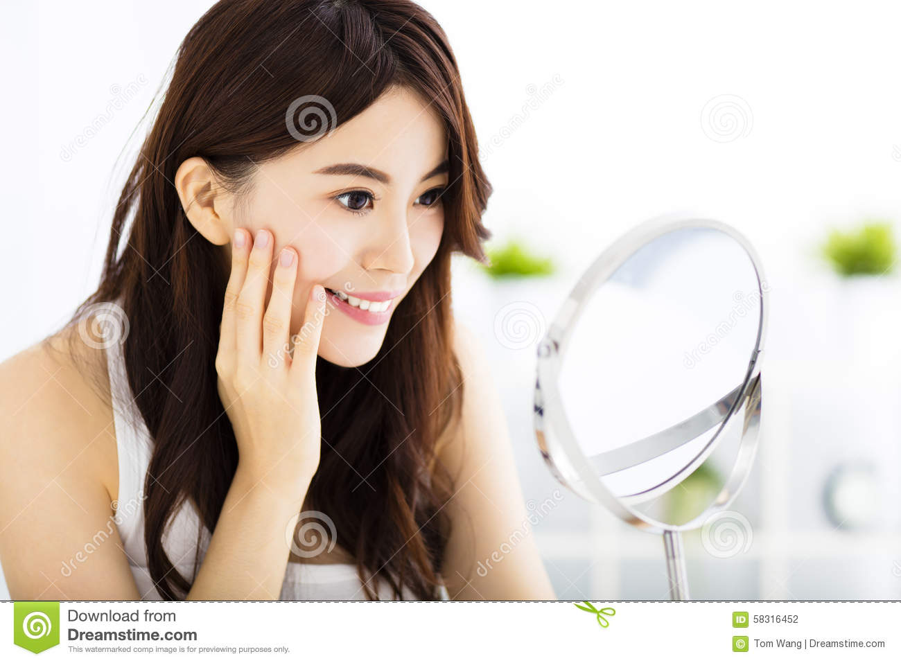 Happy young woman looking on mirror royalty free stock for Looking mirror