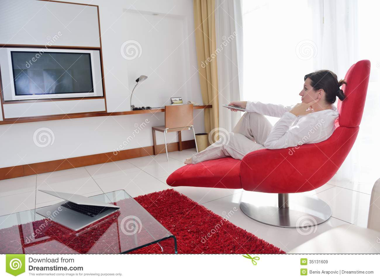 Happy Young Woman Relax At Home On Sofa Royalty Free Stock