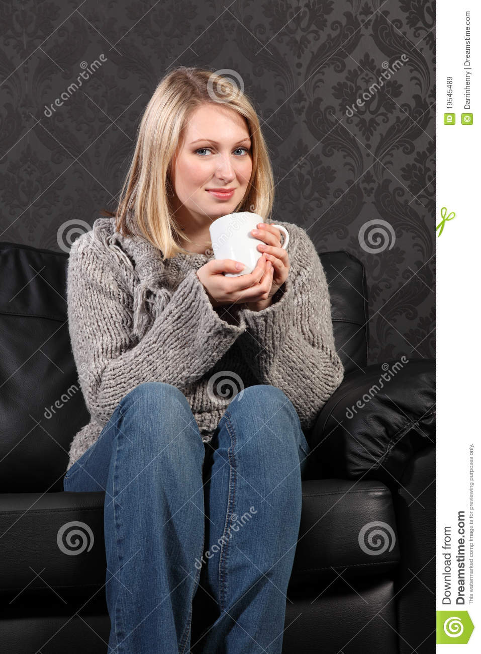 Happy Young Woman Relaxed At Home Drinking Coffee Royalty