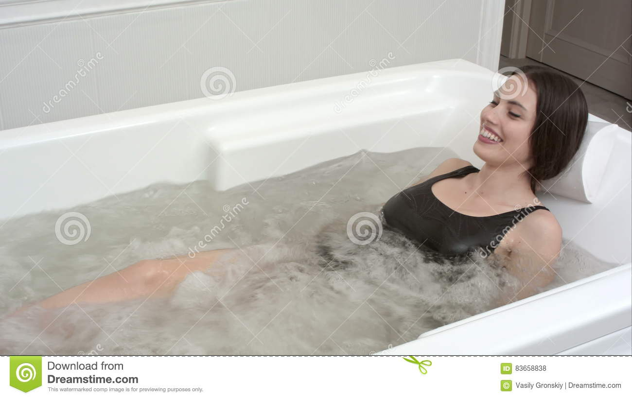 Happy Young Woman Relaxing In Jacuzzi Spa Stock Footage - Video of ...