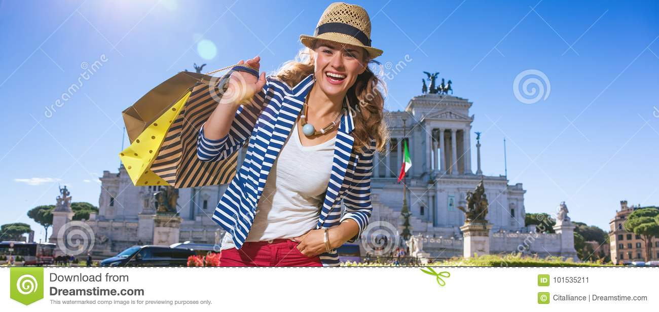 Happy young woman shopper at Piazza Venezia in Rome, Italy